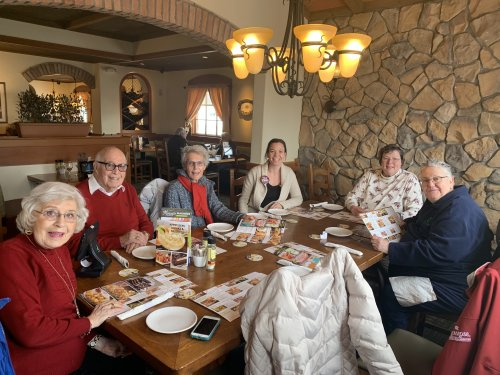 Decatur Primrose Residents worked up an appetite for Olive Garden after spending the morning Milikin University handing out treat bags for Random Acts of Kindness Day