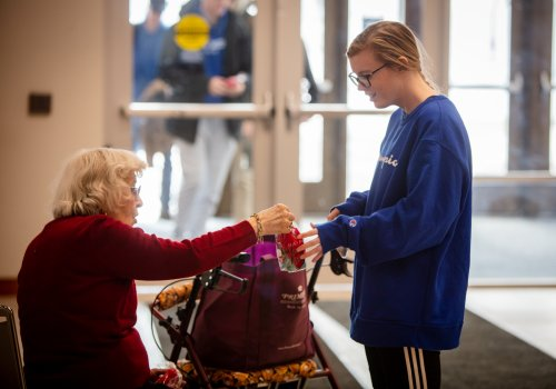 Decatur Primrose residents hand out gift bags to Millikin University Students for Random Acts Of Kindness