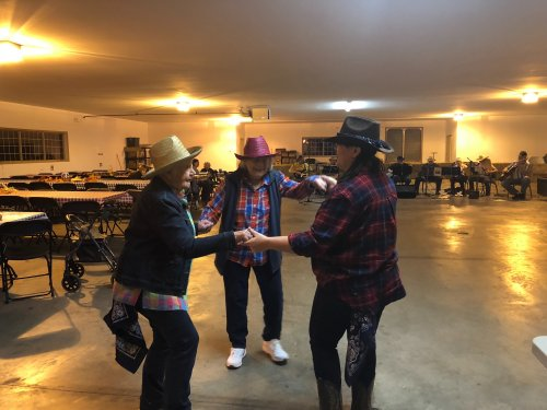 Mary, Helen and Director Leslie boot scoot and boogied the night away at our annual Hoedown in Decatur