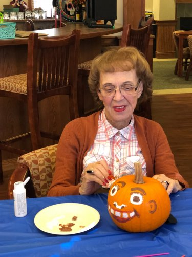 Painting pumpkins for our Halloween party