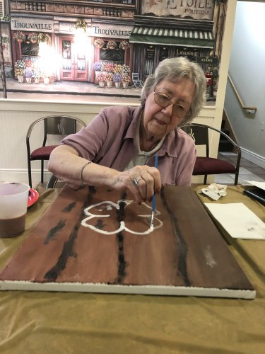 Barb has a steady hand as she paints her four leaf clover