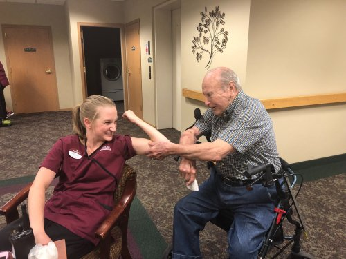 CNA Brittany and resident Bob were comparing muscles to see whose was bigger!