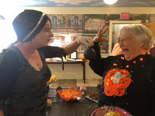 Residents weren't sure what to think of the poison apples at the Halloween Party