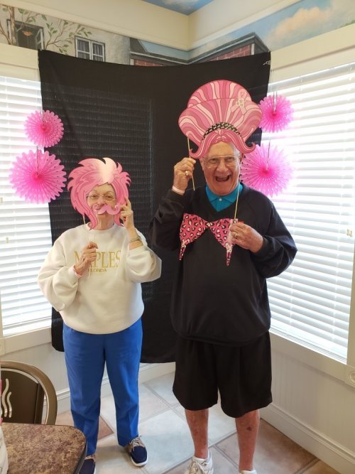 Phil and Sherry had fun with the Breast Cancer Photo Booth