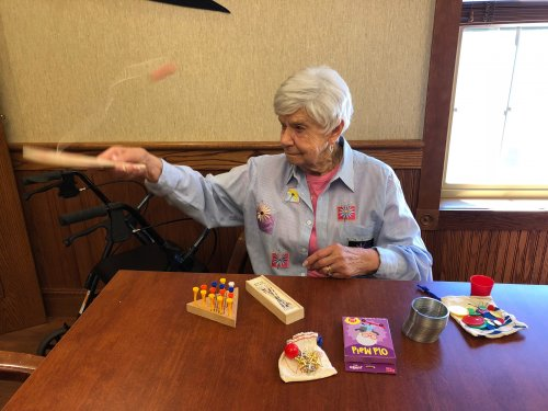 Mary playing with a variety of vintage games