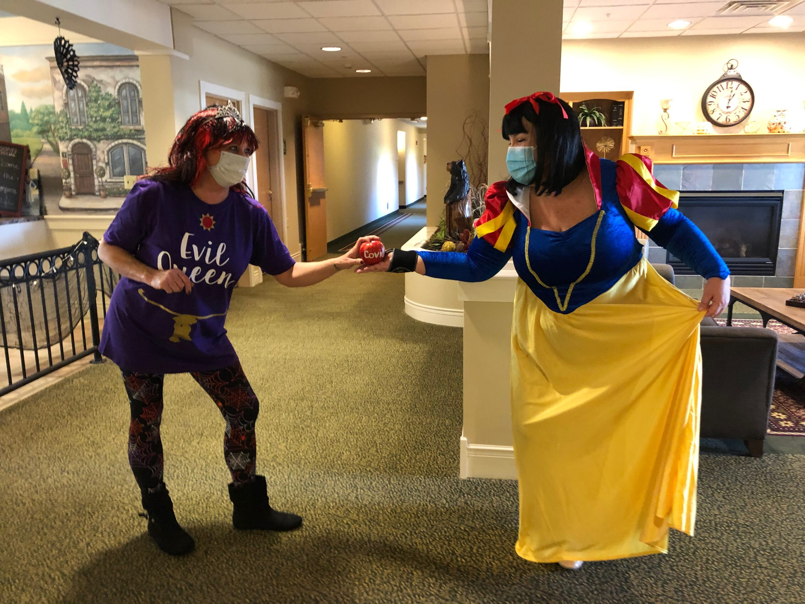 The Evil Queen offering her covid apple to Snow White