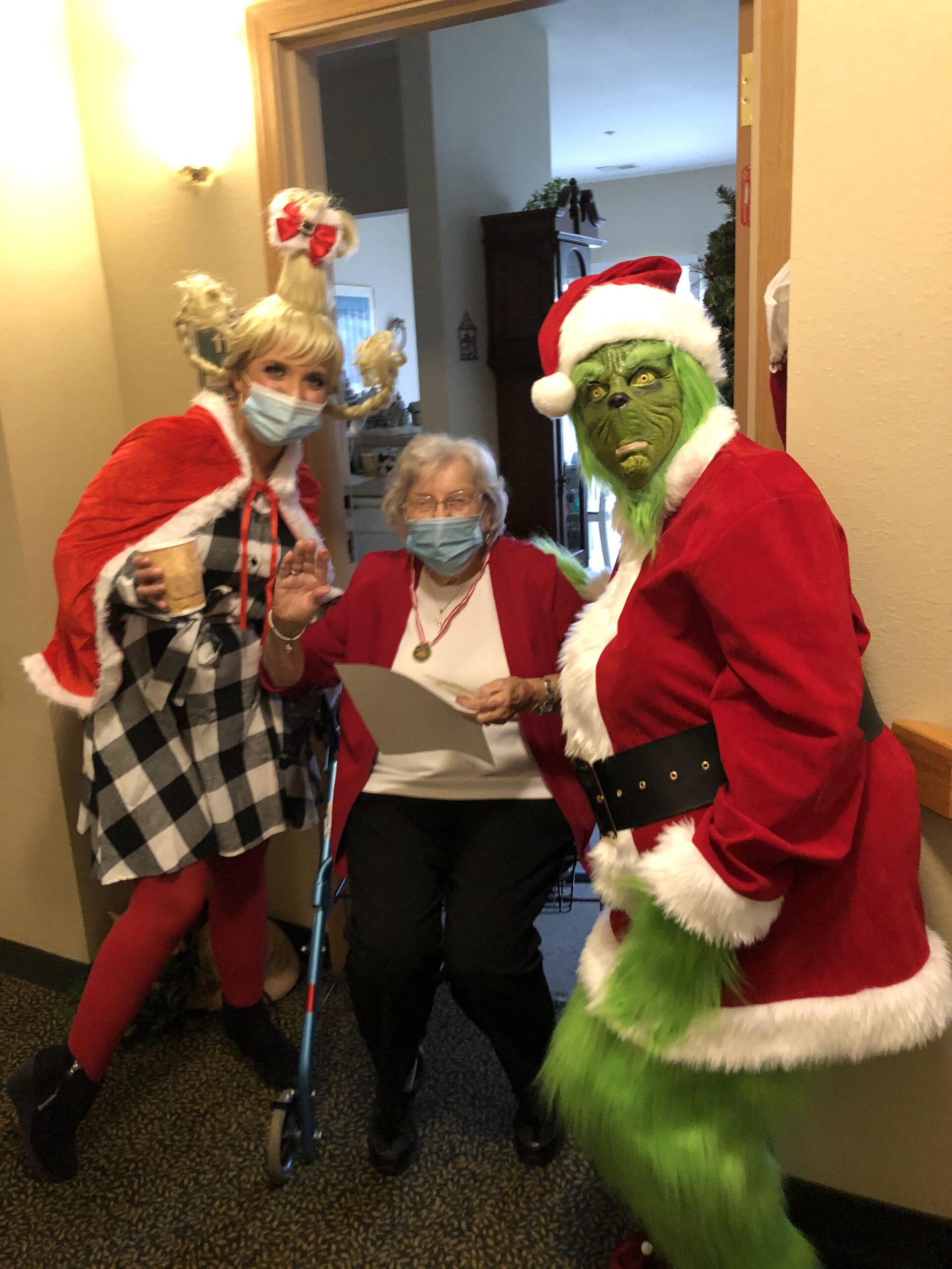 Jemmy was a bit suprised to see The Grinch and Cindy Lou Who at her door