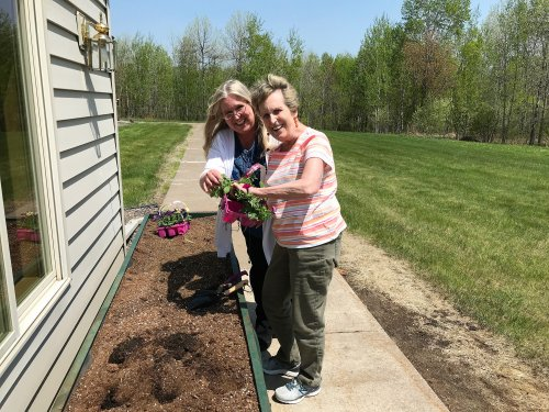 Joany and Cindy finally getting a great day to plant flowers!