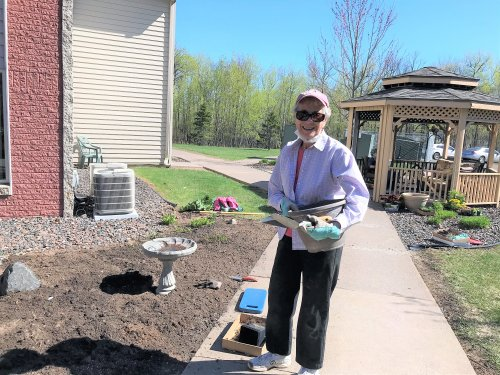 Mary working hard on the garden on such a nice day!