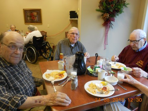 Richard, Eli and Gene talking about the Viking and Packers games for tonight while enjoying their lunch.