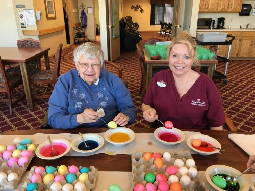 Norma and Mel our LPN having fun coloring Easter Eggs!
