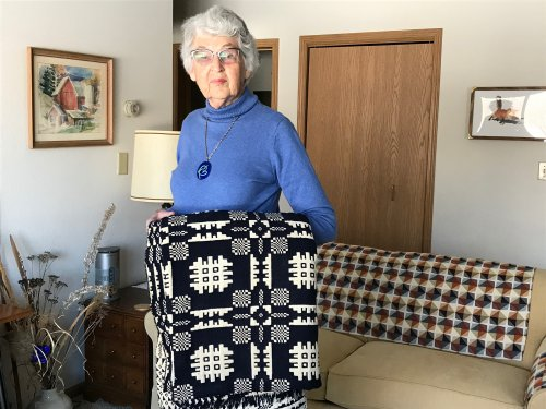 Petey sharing her indigo blanket early 1800's with the residents after learning about Eliza Lucas Pinckney 'Founding Mothers' Primrose Senior University!