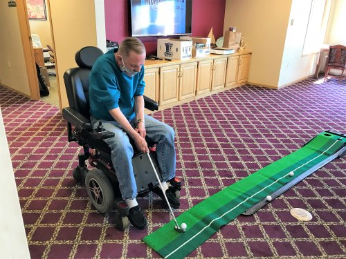 Gary trying out our new putting green!