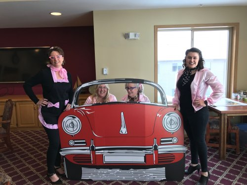 Terri DON, Cindy LEC, Dawn Admin Asst. and Rachel Sales Director having some fun during our 50's day!