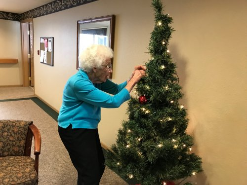 Dorothy decorating the Fireside Christmas Tree! It's feeling a lot like Christmas here at Primrose!!