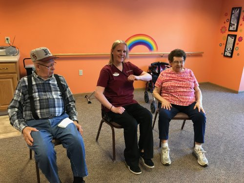 Jen exercising with the residents Jan & Bob! Sit & Be Fit!!