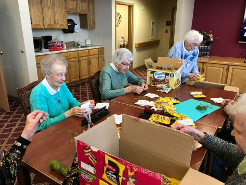 the ladies working hard at getting Random Acts of Kindness cookie bags ready for the students!