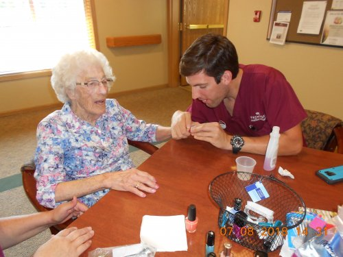 Dorothy getting her nails polished by Denton one of our CNA's