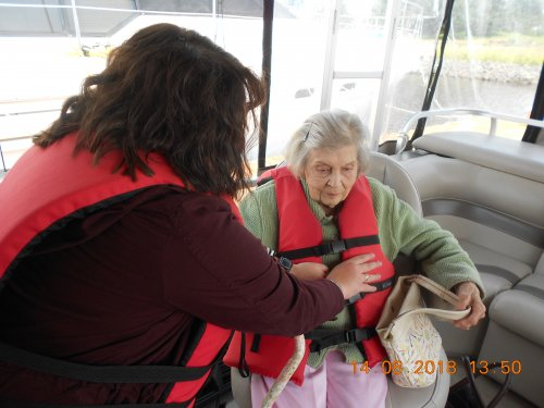Rachel helping Gerri adjust life jacket.