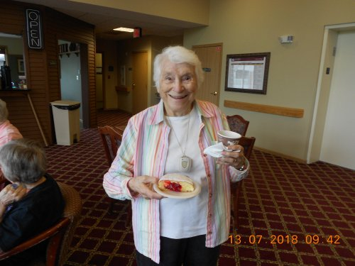 Jane enjoying her coffee and donut at Friday Morning Social