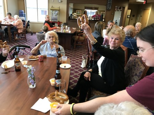 Residents enjoying German Beer and Big Pretzels for Oktoberfest!