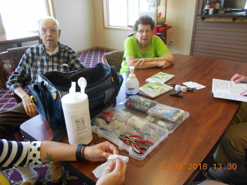 Arlo & Jan getting their hearing aides cleaned, checked, wax inspection & supplies by Karla from Hearing Associates at no charge!