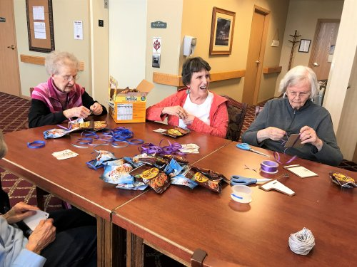 ladies working hard putting together Random Acts of Kindness goodies.