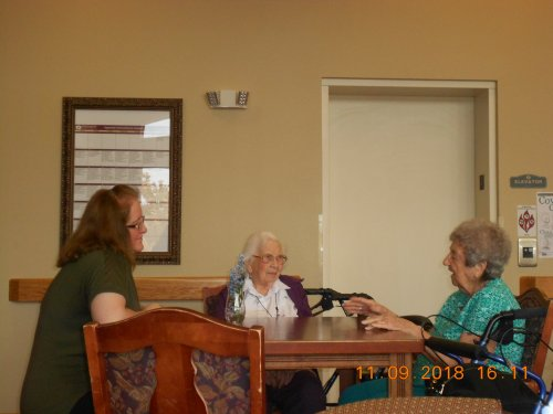 Connie one of our Housekeepers taking a moment to chat with Ellen and Virginia.