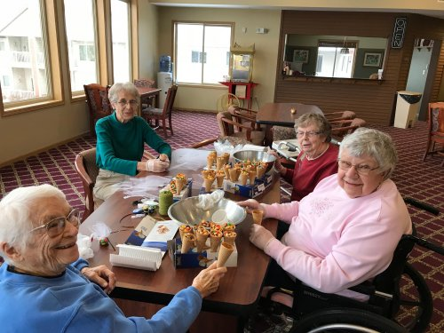 Jane, Mary, Dorothy and Norma working on our Cornconeacopia for Thanksgiving tables.