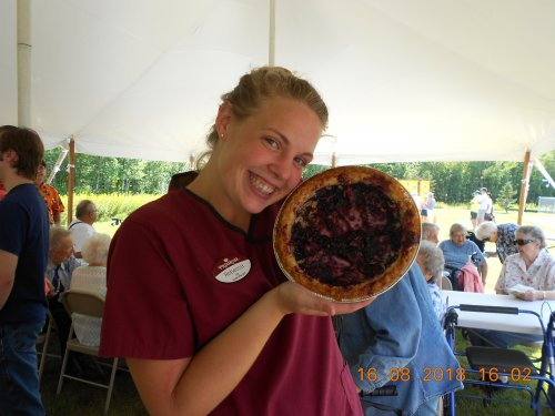 RA Becca wins the pie eating contest at the classic car show.