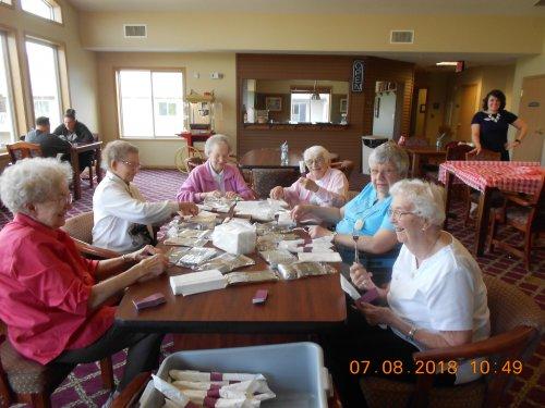 Ladies having fun wrapping silverware!