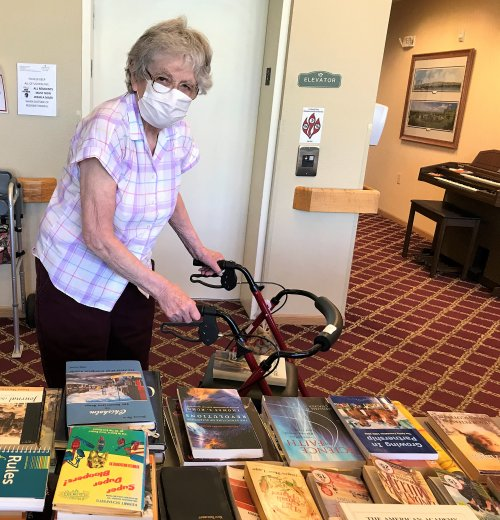 Luella doing some shopping at our rummage sale for residents and staff!