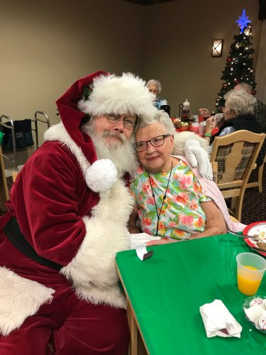 Mary Ann finding out if she is on the nice list with Santa.