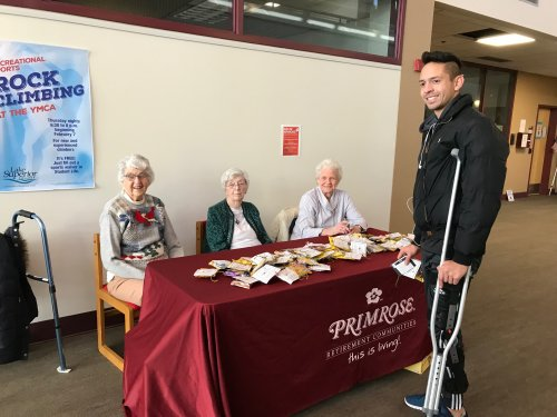 Random Acts of Kindness with Petey, Connie and Judy handing out cookies and Amazon gift cards at Lake Superior College.