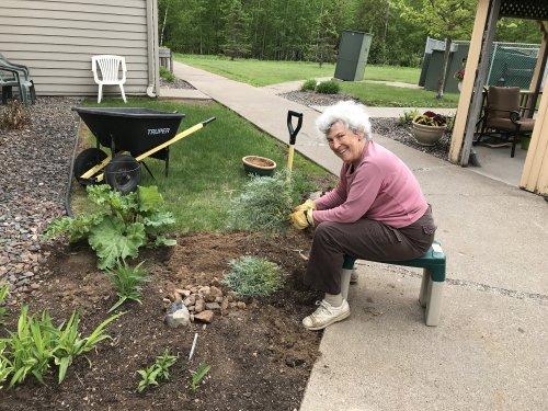 Dianna hard at work in the garden!