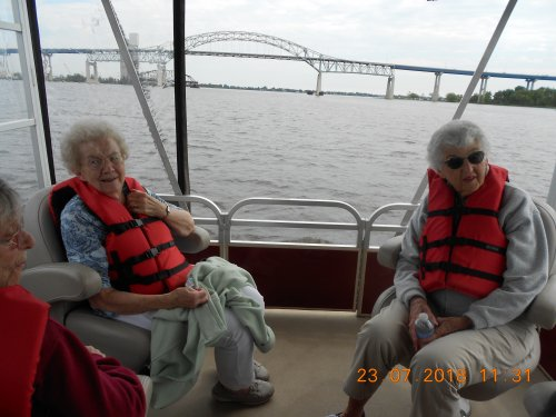 What a great day for a boat ride. Lila, Petey and Liz.