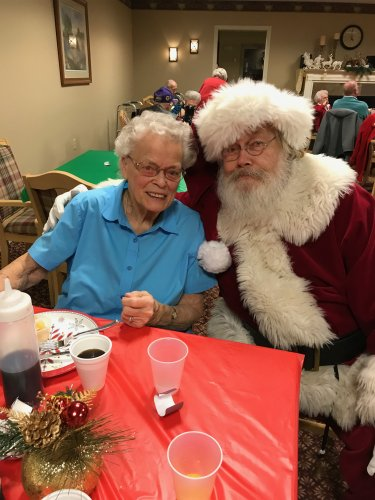 Never to old to get your picture taken with Santa. Lois telling him what she wants for Christmas!