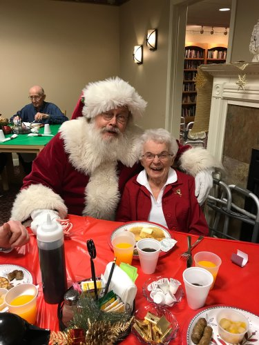Santa finding out what Janis wants for Christmas.