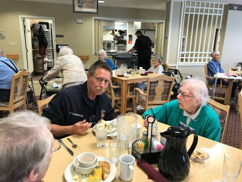 Dee and Gerry enjoying their lunch with the fire fighters.