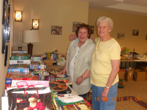 Judy and Marlene helping set up for the Rummage Sale!