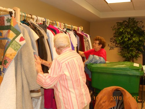 Ruth and Jan helping with setting up the Rummage Sale