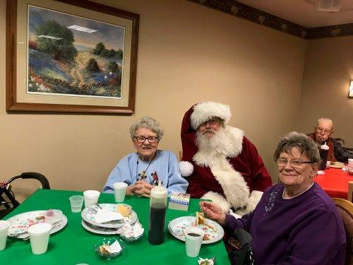 Marilyn and Barb visiting with Santa!