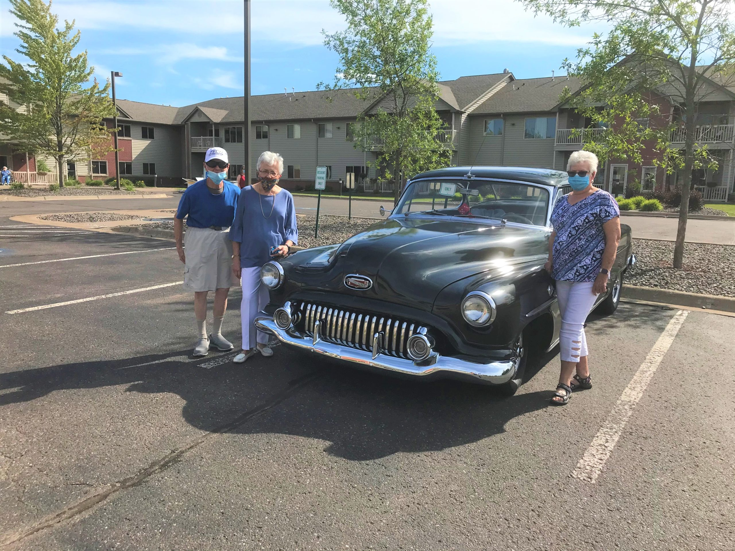 Dick and Judy T and Marge checking out the Vintage car that was in the parking lot.