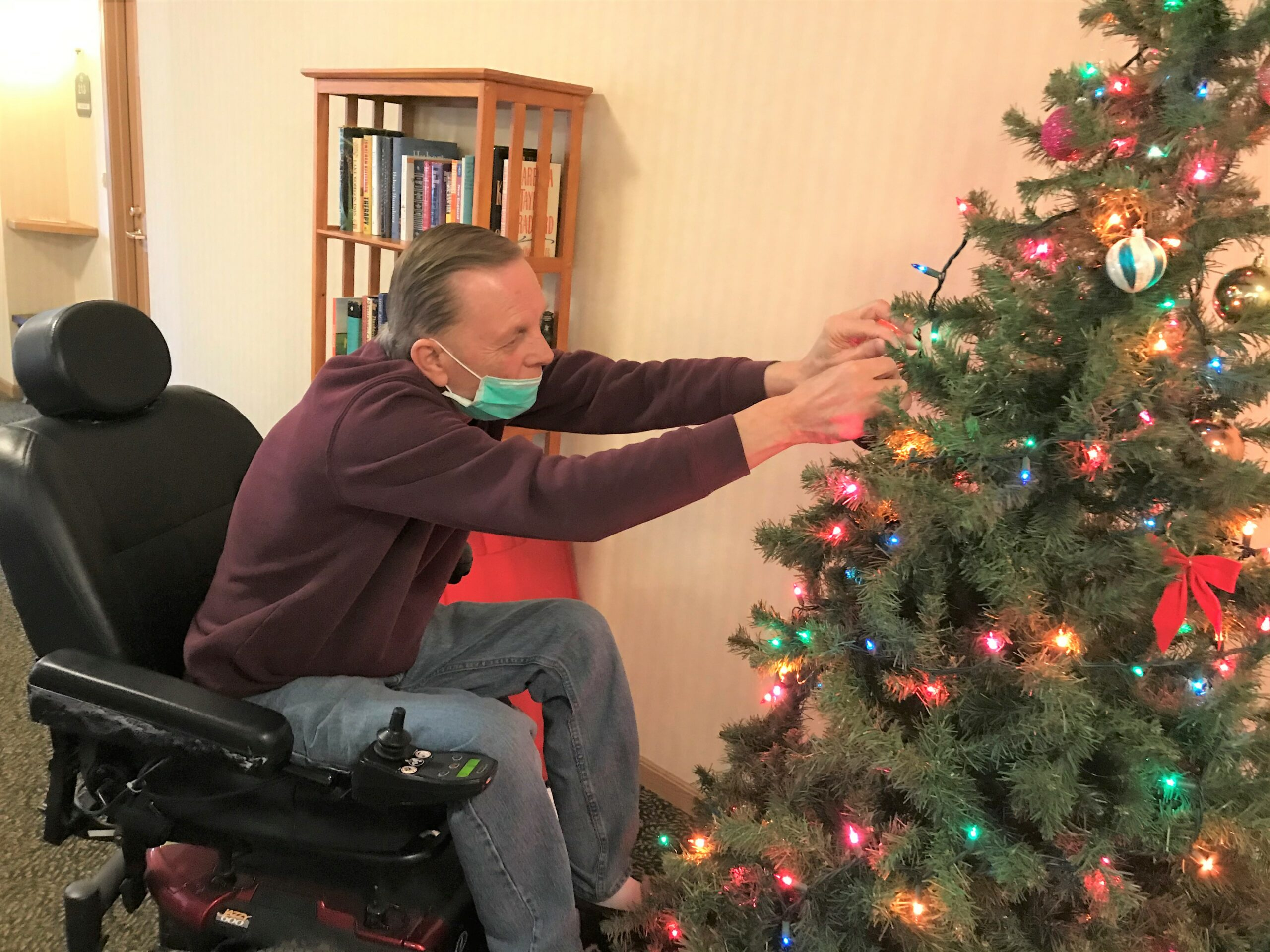 Gary helping decorate one of many Christmas trees.