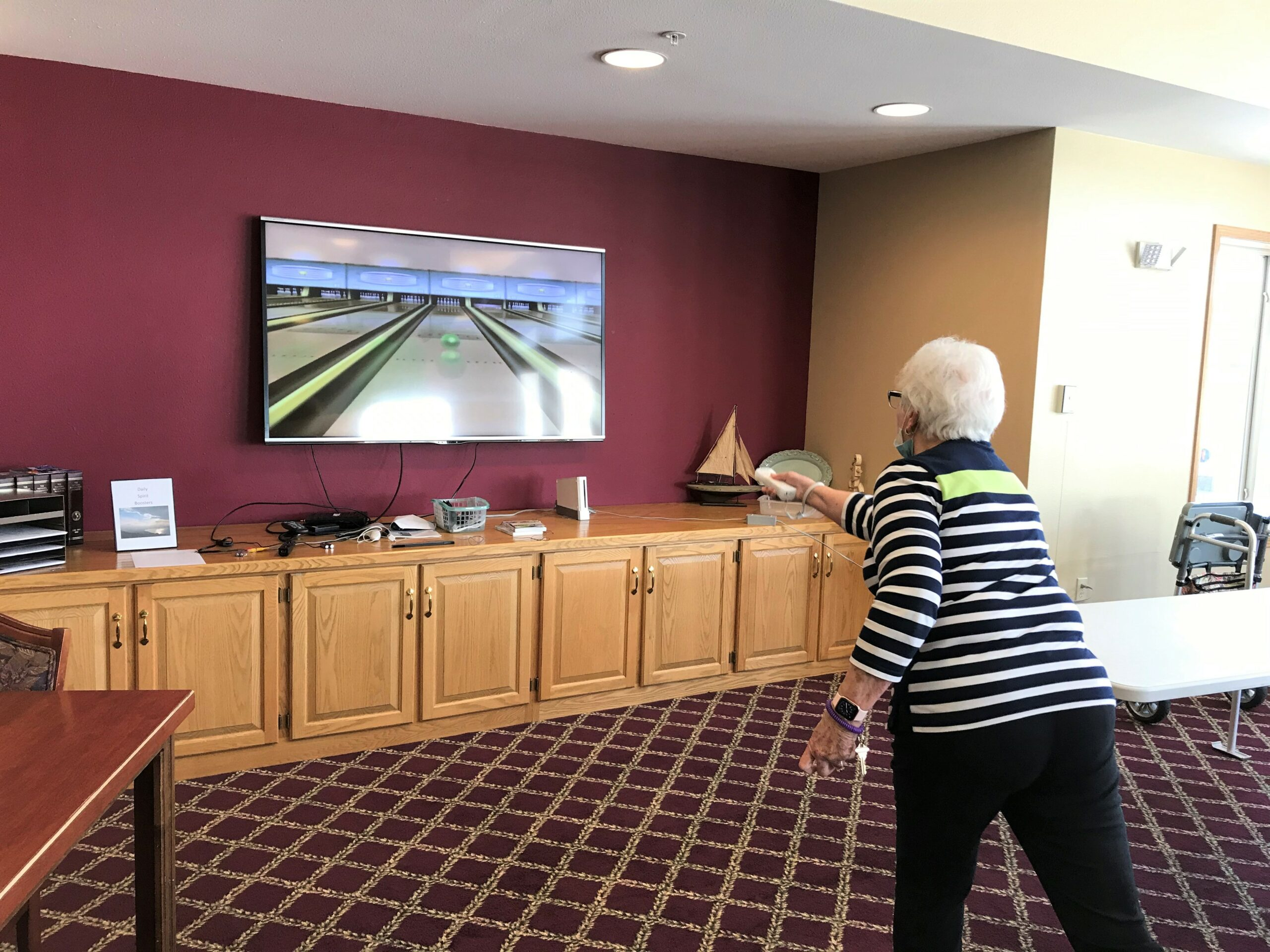 Playing a game of Wii Bowling