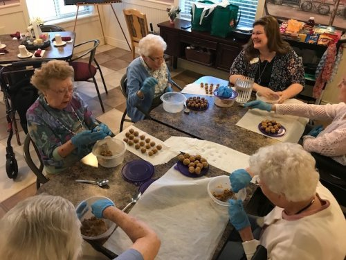 Ellie, Joan, Marie, Ruthann and Dottie are making homemade dog treats to take to the Hancock Humane Society.