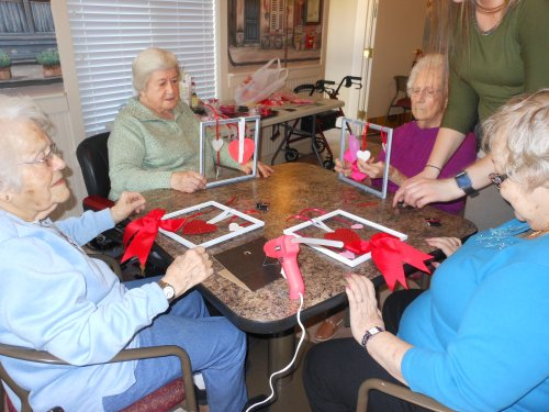 Doris, Mary Kathryn, June and Barb making adorable Valentine's Day decorations to hang on their apartment doors.