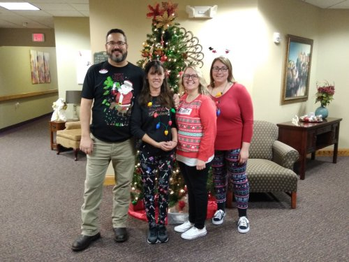 Our Maintenance Director and housekeepers participate in holiday spirit week at Primrose!