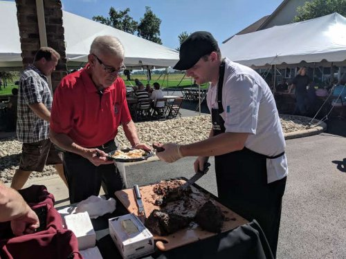 Lee C. takes some beef from the carving station from Chef Zack at the family picnic on September 15, 2018.