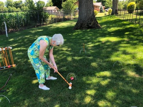 Miriam found some shade under this tree and played a little croquet while on the garden tour.